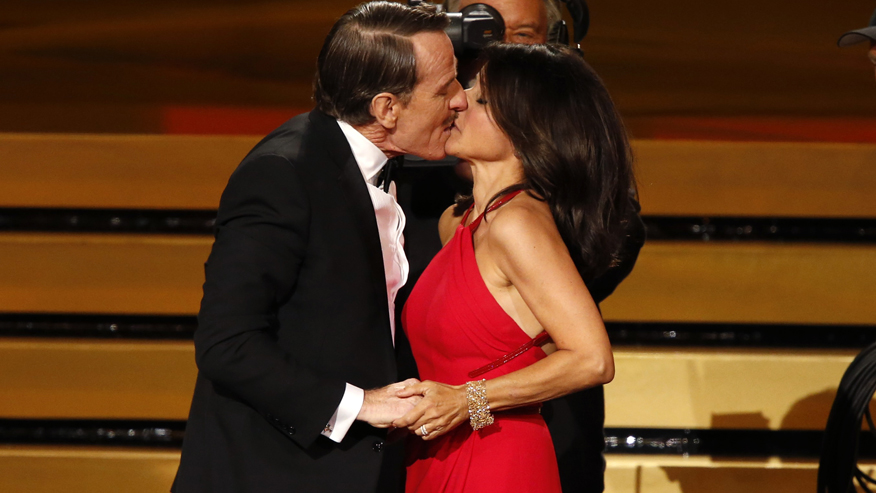 "Actor Cranston engages Julia-Louis Dreyfus in a prolonged kiss as she takes the stage to accept the award for Outstanding Lead Actress In A Comedy Series for her role in HBO's ""Veep"""